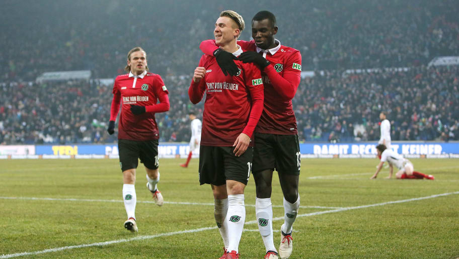 HANOVER, GERMANY - FEBRUARY 10: Iver Fossum (L),  Felix Klaus (M) and Ihlas Bebou of Hannover 96 celebrate their teams second goal scoring during the Bundesliga match between Hannover 96 and Sport-Club Freiburg at HDI-Arena on February 10, 2018 in Hanover, Germany. (Photo by Selim Sudheimer/Bongarts/Getty Images)