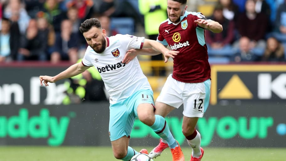BURNLEY, ENGLAND - MAY 21: Robert Snodgrass of West Ham United and Robbie Brady of Burnley battle for possession during the Premier League match between Burnley and West Ham United at Turf Moor on May 21, 2017 in Burnley, England.  (Photo by Ian MacNicol/Getty Images)