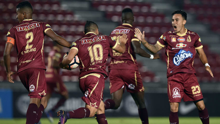 Colombia's Deportes Tolima Cleider Alzate (2nd-L) celebrates with teammates after scoring against Bolivia's Bolivar during their Copa Sudamericana football match at the Manuel Murillo Toro stadium in Ibague, Colombia on March 2, 2017. / AFP PHOTO / GUILLERMO LEGARIA        (Photo credit should read GUILLERMO LEGARIA/AFP/Getty Images)