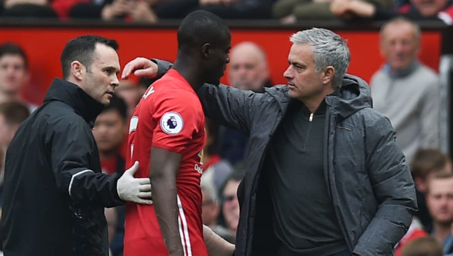 Manchester United's Ivorian defender Eric Bailly (2L) is greeted by Manchester United's Portuguese manager Jose Mourinho (R) after being substituted with an injury during the English Premier League football match between Manchester United and Swansea City at Old Trafford in Manchester, north west England, on April 30, 2017. / AFP PHOTO / Oli SCARFF / RESTRICTED TO EDITORIAL USE. No use with unauthorized audio, video, data, fixture lists, club/league logos or 'live' services. Online in-match use limited to 75 images, no video emulation. No use in betting, games or single club/league/player publications.  /         (Photo credit should read OLI SCARFF/AFP/Getty Images)