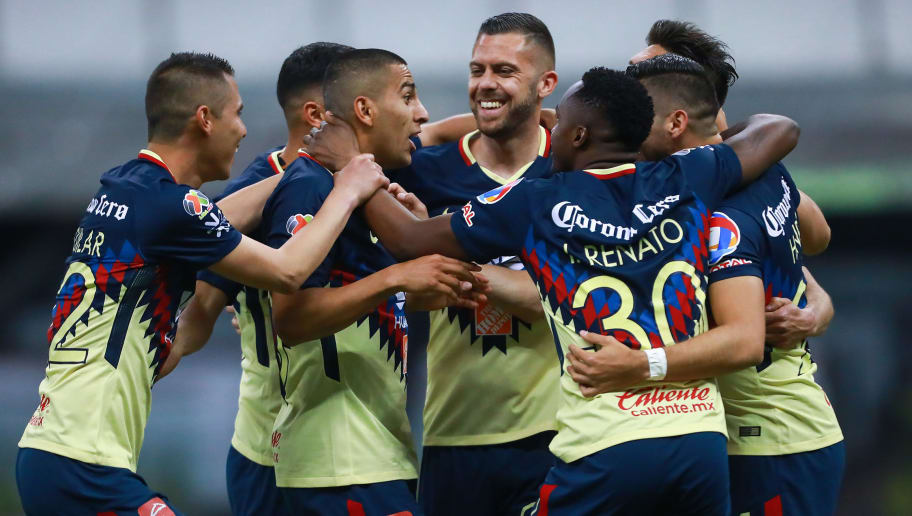MEXICO CITY, MEXICO - FEBRUARY 03: Henry Martin of America celebrates with teammates after scoring the third goal of his team during the 5th round match between America and Lobos BUAP as part of the Torneo Clausura 2018 Liga MX at Azteca Stadium on February 03, 2018 in Mexico City, Mexico. (Photo by Hector Vivas/Getty Images)