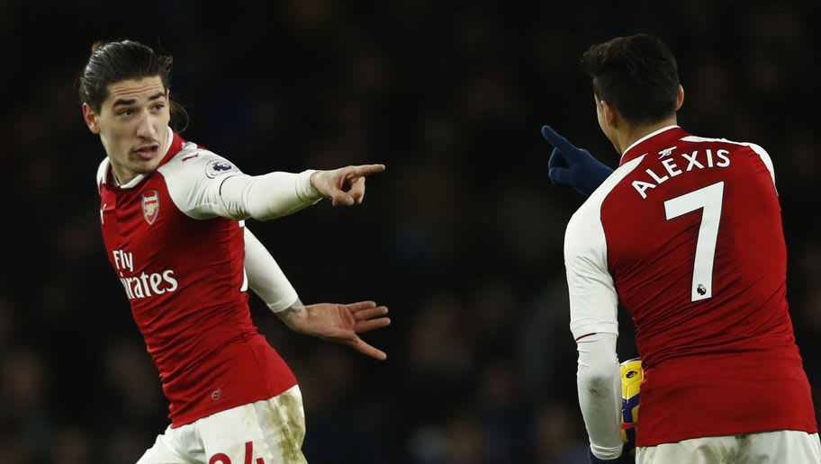 Arsenal's Spanish defender Hector Bellerin (L) celebrates after scoring their second goal with Arsenal's Chilean striker Alexis Sanchez during the English Premier League football match between Arsenal and Chelsea at the Emirates Stadium in London on January 3, 2018.  / AFP PHOTO / Adrian DENNIS / RESTRICTED TO EDITORIAL USE. No use with unauthorized audio, video, data, fixture lists, club/league logos or 'live' services. Online in-match use limited to 75 images, no video emulation. No use in betting, games or single club/league/player publications.  /         (Photo credit should read ADRIAN DENNIS/AFP/Getty Images)