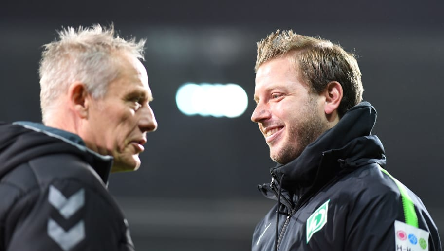 BREMEN, GERMANY - DECEMBER 20:  Christian Streich, head coach of Freiburg greerts Florian Kohfeldt, head coach of Bremen during the DFB Cup match between Werder Bremen and SC Freiburg at Weserstadion on December 20, 2017 in Bremen, Germany.  (Photo by Stuart Franklin/Bongarts/Getty Images)