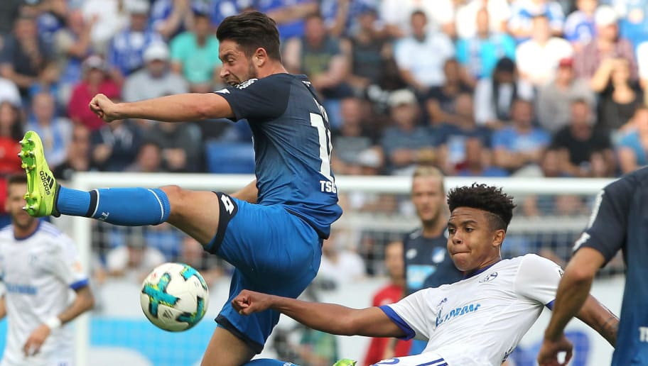 Hoffenheim's German forward Mark Uth (L) and Schalke's US midfielder Weston McKennie vie for the ball during the German first division Bundesliga football match between TSG Hoffenheim and FC Schalke 04 in Sinsheim, western Germany, on September 23, 2017. / AFP PHOTO / Amelie QUERFURTH / RESTRICTIONS: DURING MATCH TIME: DFL RULES TO LIMIT THE ONLINE USAGE TO 15 PICTURES PER MATCH AND FORBID IMAGE SEQUENCES TO SIMULATE VIDEO. == RESTRICTED TO EDITORIAL USE == FOR FURTHER QUERIES PLEASE CONTACT DFL DIRECTLY AT + 49 69 650050         (Photo credit should read AMELIE QUERFURTH/AFP/Getty Images)