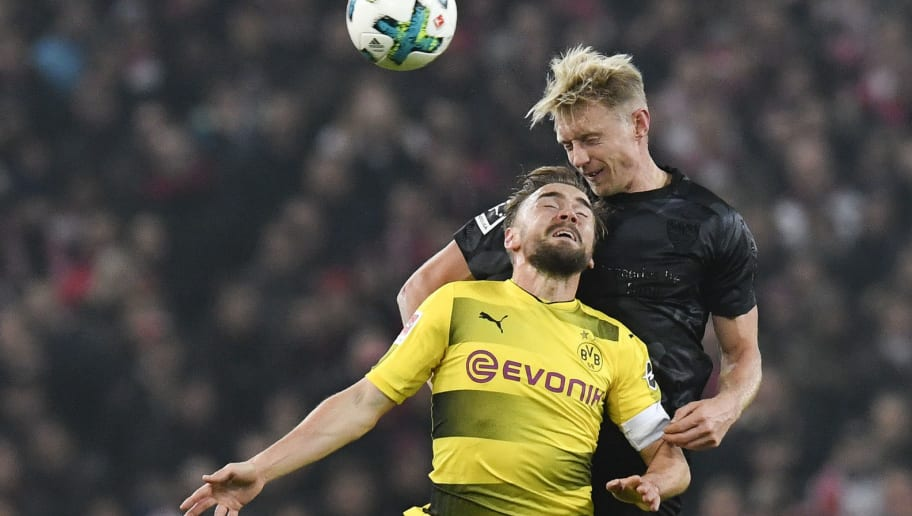 Stuttgart's defender Andreas Beck (R) and Dortmund's defender Marcel Schmelzer vie for the ball during the German first division Bundesliga football match VfB Stuttgart vs BVB Borussia Dortmund in Stuttgart, southwestern Germany, on November 17, 2017. / AFP PHOTO / THOMAS KIENZLE / RESTRICTIONS: DURING MATCH TIME: DFL RULES TO LIMIT THE ONLINE USAGE TO 15 PICTURES PER MATCH AND FORBID IMAGE SEQUENCES TO SIMULATE VIDEO. == RESTRICTED TO EDITORIAL USE == FOR FURTHER QUERIES PLEASE CONTACT DFL DIRECTLY AT + 49 69 650050         (Photo credit should read THOMAS KIENZLE/AFP/Getty Images)
