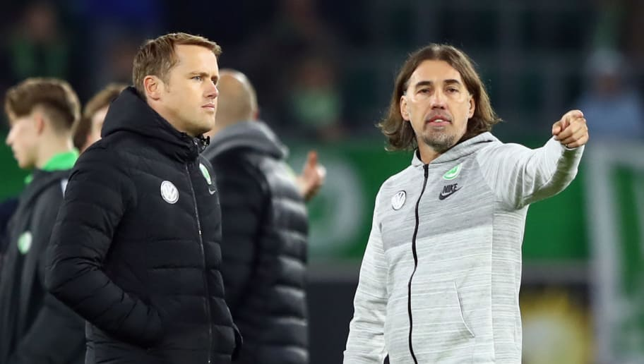 WOLFSBURG, GERMANY - NOVEMBER 05:  Head coach Martin Schmidt and team manager Olaf Rebbe of Wolfsburg react after the Bundesliga match between VfL Wolfsburg and Hertha BSC at Volkswagen Arena on November 5, 2017 in Wolfsburg, Germany.  (Photo by Martin Rose/Bongarts/Getty Images)