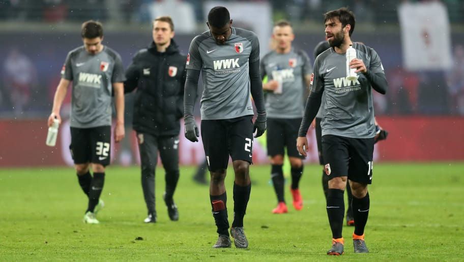 LEIPZIG, GERMANY - FEBRUARY 09:  Players of FC Augsburg look dejected after losing the Bundesliga match between RB Leipzig and FC Augsburg at Red Bull Arena on February 9, 2018 in Leipzig, Germany.  (Photo by Boris Streubel/Bongarts/Getty Images)