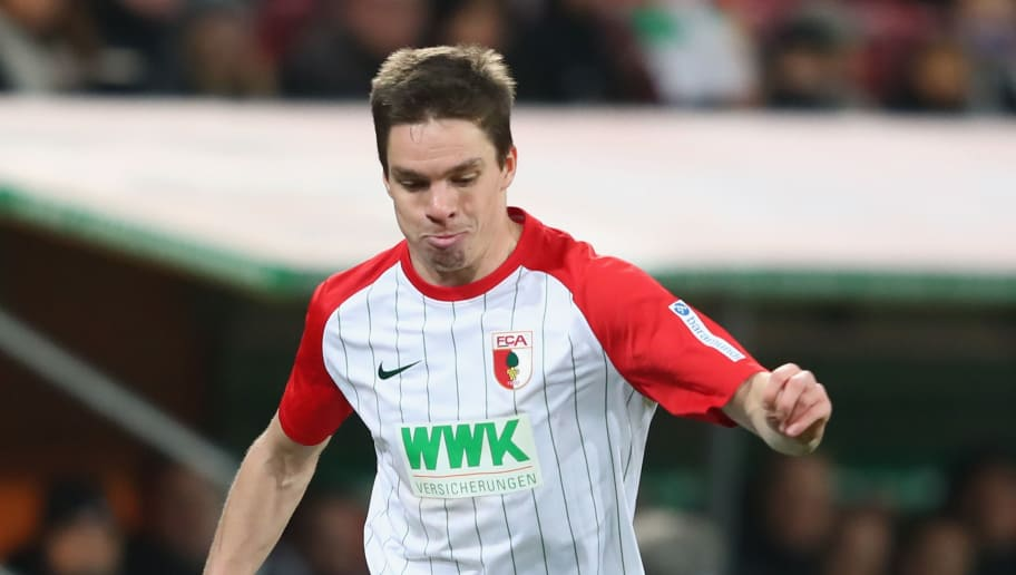 AUGSBURG, GERMANY - DECEMBER 10:  Raphael Framberger of Augsburg runs with the ball during the Bundesliga match between FC Augsburg and Hertha BSC at WWK-Arena on December 10, 2017 in Augsburg, Germany.  (Photo by Alexander Hassenstein/Bongarts/Getty Images)