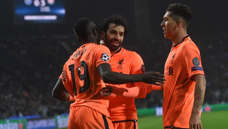 Liverpool's Senegalese midfielder Sadio Mane (L) celebrates with Liverpool's Egyptian midfielder Mohamed Salah and Liverpool's Brazilian midfielder Roberto Firmino (R) after scoring their third goal during the UEFA Champions League round of sixteen first leg football match between FC Porto and Liverpool at the Dragao stadium in Porto, Portugal on February 14, 2018. Liverpool won the game 5-0. / AFP PHOTO / Francisco LEONG        (Photo credit should read FRANCISCO LEONG/AFP/Getty Images)