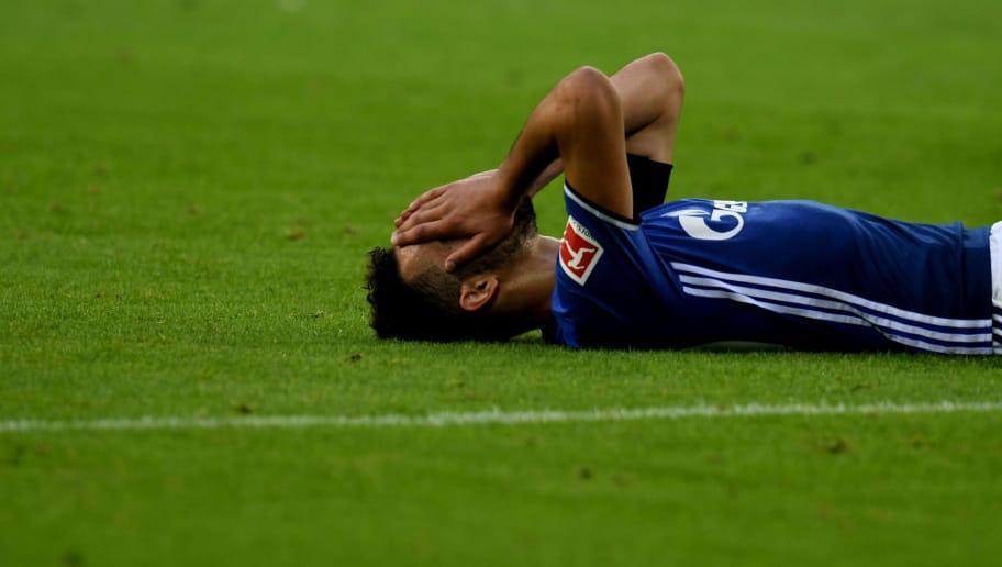 Schalke's midfielder Nabil Bentaleb reacts during the German First division Bundesliga football match FC Schalke 04 vs RB Leipzig in Gelsenkirchen, western Germany, on August 19, 2017. / AFP PHOTO / PATRIK STOLLARZ        (Photo credit should read PATRIK STOLLARZ/AFP/Getty Images)