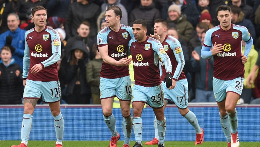 Burnley players celebrate after Burnley's Icelandic midfielder Johann Berg Gudmundsson scored their first goal to equalise 1-1 during the English Premier League football match between Burnley and Manchester City at Turf Moor in Burnley, north west England on February 3, 2018. / AFP PHOTO / Oli SCARFF / RESTRICTED TO EDITORIAL USE. No use with unauthorized audio, video, data, fixture lists, club/league logos or 'live' services. Online in-match use limited to 75 images, no video emulation. No use in betting, games or single club/league/player publications.  /         (Photo credit should read OLI SCARFF/AFP/Getty Images)