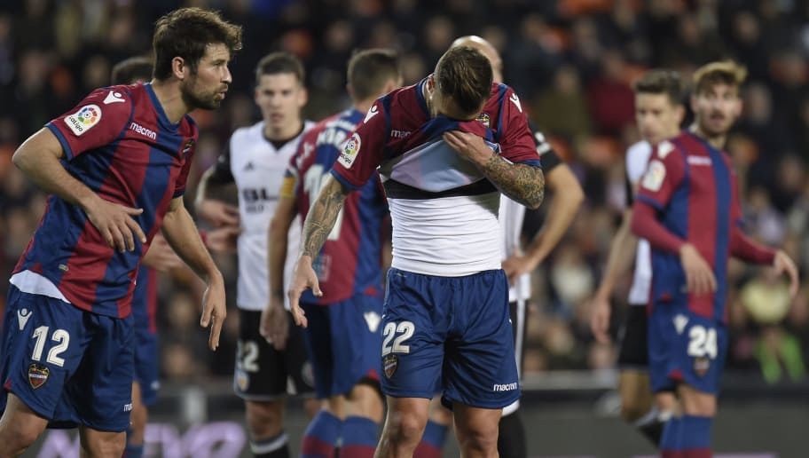 Levante's defender Antonio Luna gestures during the Spanish league football match between Valencia CF and Levante UD at the Mestalla stadium in Valencia on February 11, 2018. / AFP PHOTO / JOSE JORDAN        (Photo credit should read JOSE JORDAN/AFP/Getty Images)