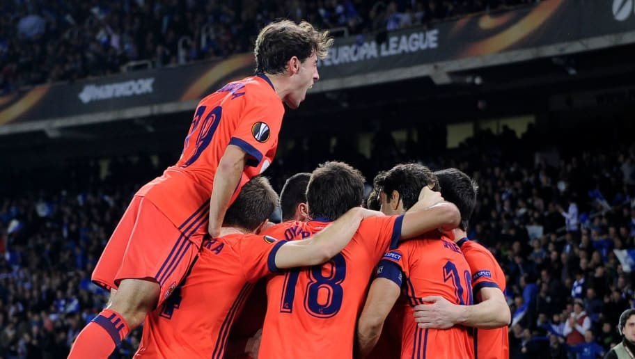 Real Sociedad players celebrate their second goal during the UEFA Europa League first leg round of 32 football match between Real Sociedad and FC Salzburg at the Anoeta stadium in San Sebastian on February 15, 2018. / AFP PHOTO / ANDER GILLENEA        (Photo credit should read ANDER GILLENEA/AFP/Getty Images)