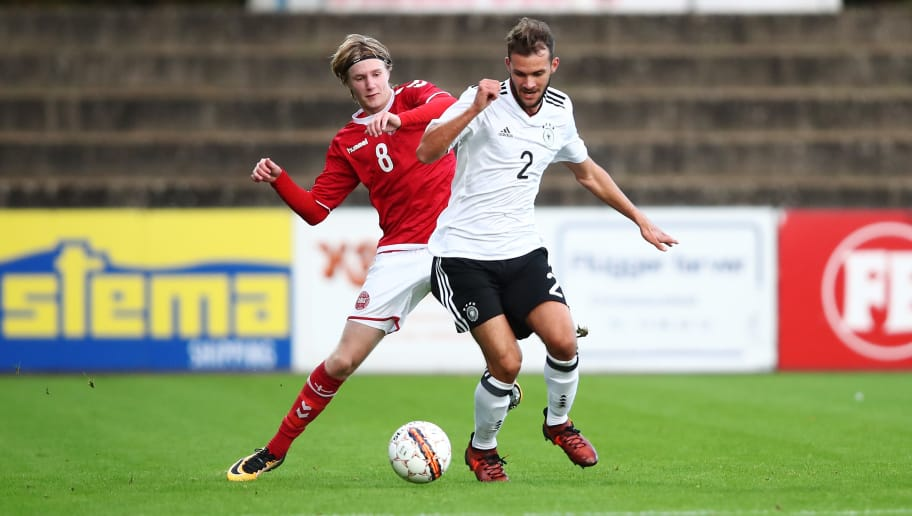 HADERSLEV, DENMARK - OCTOBER 05:  Simon Asta (R) of Germany and Jeppe Pedersen (L) of Denmark compete for the ball during the Mens U17 international friendly match between Denmark and Germany at Sydbank Park Stadion on October 5, 2017 in Haderslev, Denmark.  (Photo by Oliver Hardt/Bongarts/Getty Images)