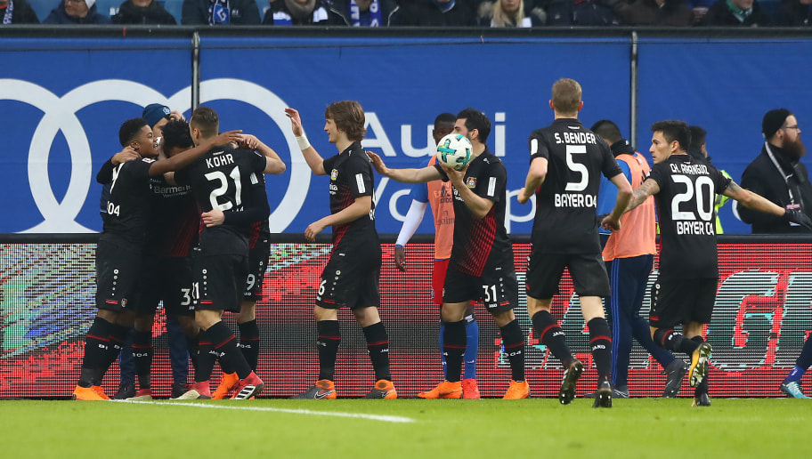 HAMBURG, GERMANY - FEBRUARY 17: Players of Leverkusen celebrate after Kai Havertz of Bayer Leverkusen (covered) scored a goal to make it 0:2 during the Bundesliga match between Hamburger SV and Bayer 04 Leverkusen at Volksparkstadion on February 17, 2018 in Hamburg, Germany. (Photo by Martin Rose/Bongarts/Getty Images)