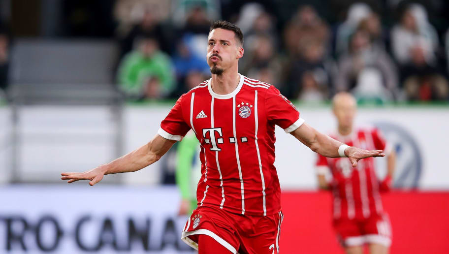 Bayern Munich's German forward Sandro Wagner celebrates after scoring his team's first goal during the German first division Bundesliga football match between VfL Wolfsburg and FC Bayern Munich on February 17, 2018 in Wolfsburg.  / AFP PHOTO / Ronny Hartmann / RESTRICTIONS: DURING MATCH TIME: DFL RULES TO LIMIT THE ONLINE USAGE TO 15 PICTURES PER MATCH AND FORBID IMAGE SEQUENCES TO SIMULATE VIDEO. == RESTRICTED TO EDITORIAL USE == FOR FURTHER QUERIES PLEASE CONTACT DFL DIRECTLY AT + 49 69 650050         (Photo credit should read RONNY HARTMANN/AFP/Getty Images)