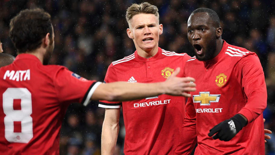 HUDDERSFIELD, ENGLAND - FEBRUARY 17:  Romelu Lukaku celebrates with teammates Juan Mata and Scott McTominay after scoring his sides first goal during the The Emirates FA Cup Fifth Round between Huddersfield Town v Manchester United on February 17, 2018 in Huddersfield, United Kingdom.  (Photo by Gareth Copley/Getty Images)