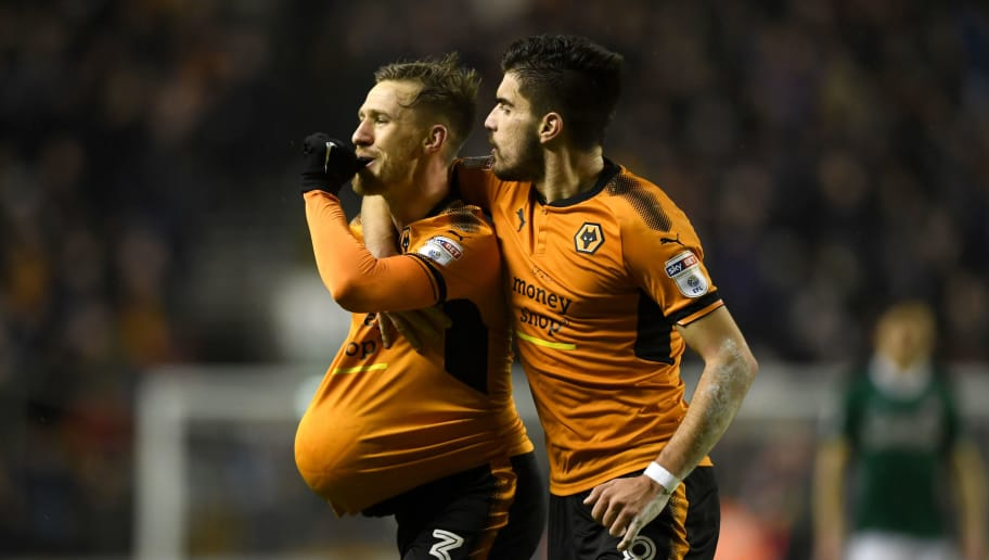 WOLVERHAMPTON, ENGLAND - JANUARY 02:  Barry Douglas of Wolverhampton Wanderers celebrates scoring his team's second goal with Ruben Neves during the Sky Bet Championship match between Wolverhampton and Brentford at Molineux on January 2, 2018 in Wolverhampton, England.  (Photo by Gareth Copley/Getty Images)