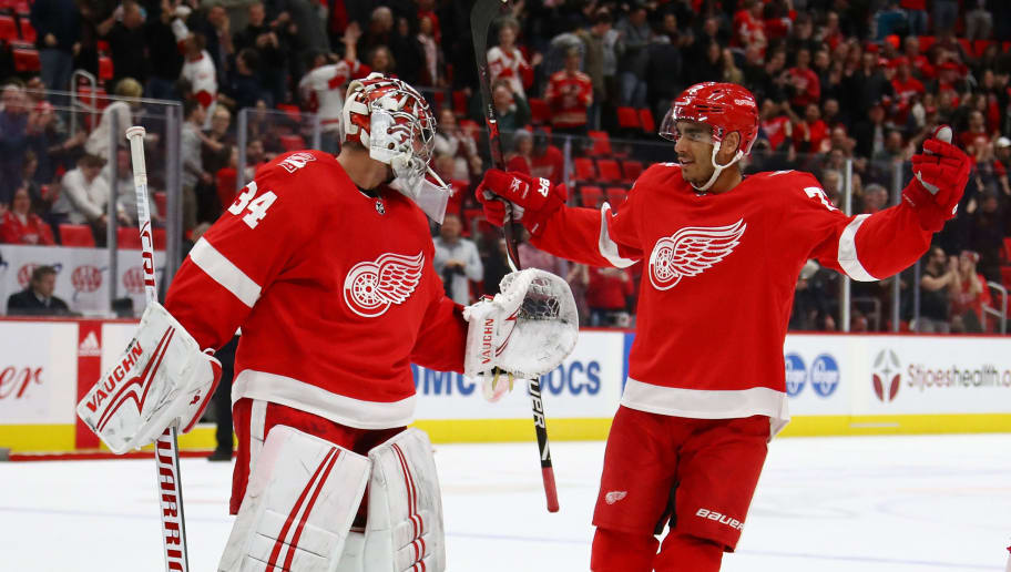 DETROIT, MI - JANUARY 31: Petr Mrazek #34 of the Detroit Red Wings celebrates a 2-1 shootout win with Andreas Athanasiou #72 while playing the San Jose Sharks at Little Caesars Arena on January 31, 2018 in Detroit, Michigan. Detroit won the game 2-1 in a shootout. (Photo by Gregory Shamus/Getty Images)