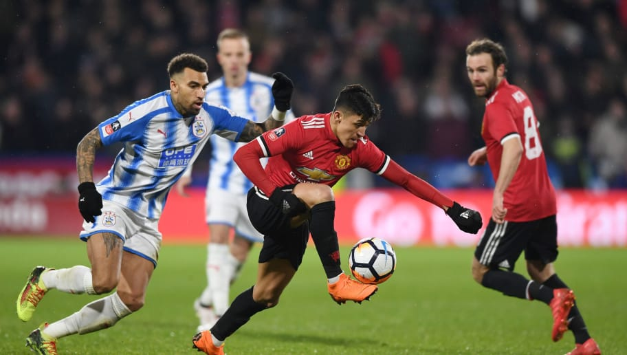HUDDERSFIELD, ENGLAND - FEBRUARY 17:  Danny Williams of Huddersfield Town chases down Alexis Sanchez of Manchester United during the The Emirates FA Cup Fifth Round between Huddersfield Town v Manchester United on February 17, 2018 in Huddersfield, United Kingdom.  (Photo by Gareth Copley/Getty Images)