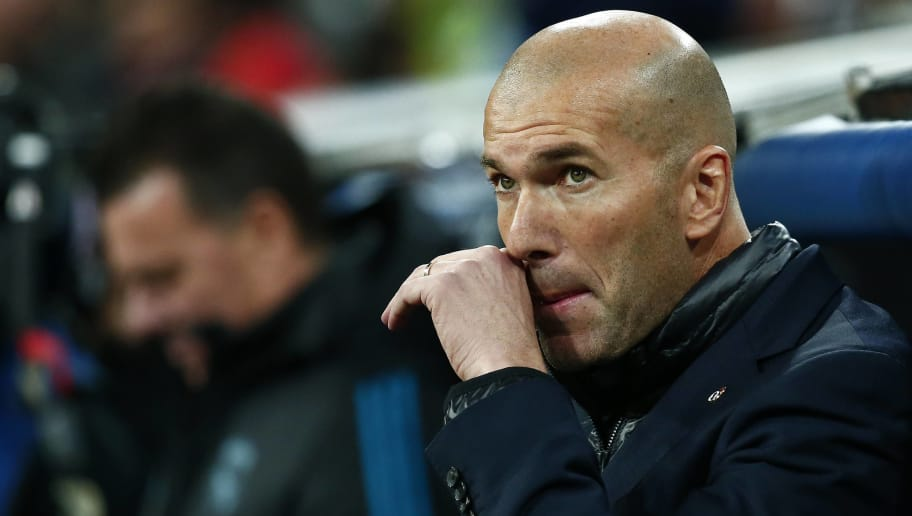 MADRID, SPAIN - FEBRUARY 14: Head coach Zinedine Zidane of Real Madrid CF reacts from the bench prior to start the UEFA Champions League Round of 16 First Leg  match between Real Madrid and Paris Saint-Germain at Estadio Santiago Bernabeu on February 14, 2018 in Madrid, Spain. (Photo by Gonzalo Arroyo Moreno/Getty Images)