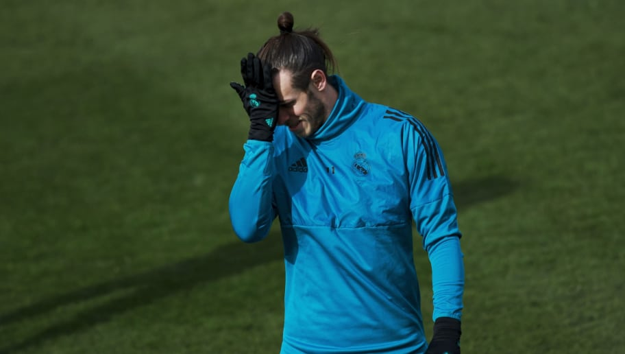 MADRID, SPAIN - FEBRUARY 13:  Gareth Bale of Real Madrid CF reacts during a training session at Valdebebas training ground ahead their Round of 16 first leg UEFA Champions League match against Paris Saint-Germain Football Club  on February 13, 2018 in Madrid, Spain.  (Photo by Gonzalo Arroyo Moreno/Getty Images)