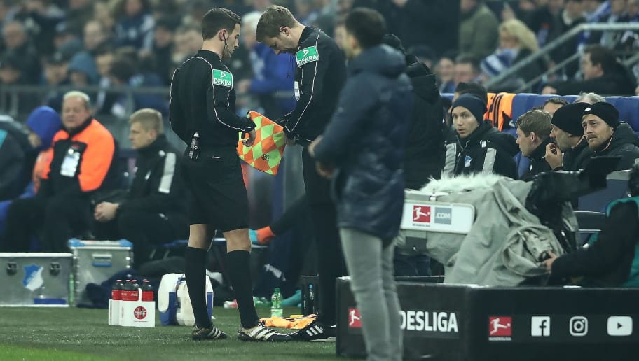 GELSENKIRCHEN, GERMANY - FEBRUARY 17: The fourth official Guido Kleve (r) speaks with referee Benjamin Brand comes on as a new linesman after Robert Schroeder (not seen) got injured during the Bundesliga match between FC Schalke 04 and TSG 1899 Hoffenheim at Veltins-Arena on February 17, 2018 in Gelsenkirchen, Germany. (Photo by Christof Koepsel/Bongarts/Getty Images)