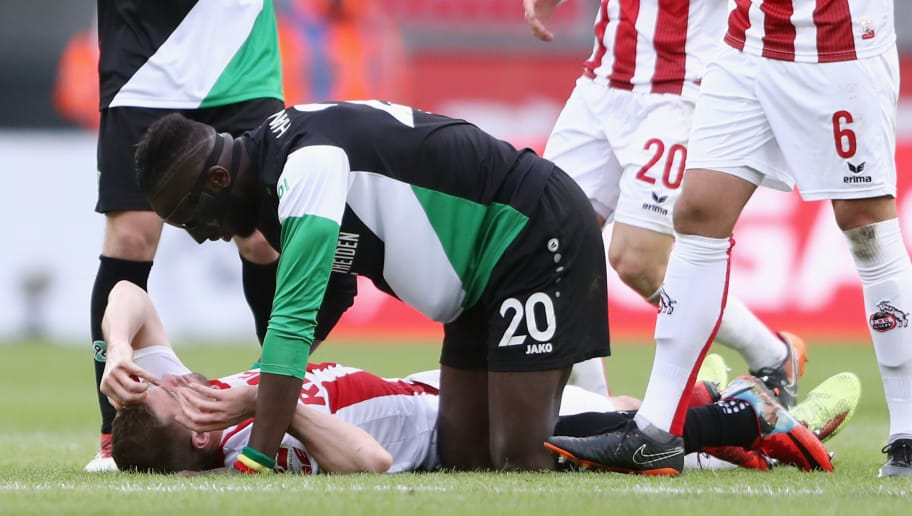COLOGNE, GERMANY - FEBRUARY 17: Salif Sane of Hannover looks after Simon Terodde of Koeln during the Bundesliga match between 1. FC Koeln and Hannover 96 at RheinEnergieStadion on February 17, 2018 in Cologne, Germany.  (Photo by Alex Grimm/Bongarts/Getty Images)