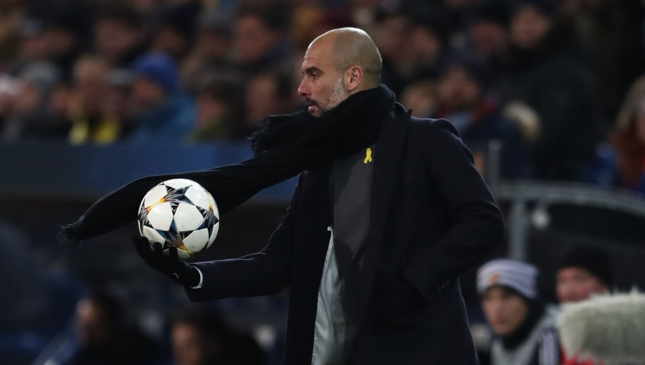 BASEL, SWITZERLAND - FEBRUARY 13: Pep Guardiola the head coach / manager of Manchester City with the ball during the UEFA Champions League Round of 16 First Leg match between FC Basel and Manchester City at St. Jakob-Park on February 13, 2018 in Basel, Switzerland. (Photo by Catherine Ivill/Getty Images)