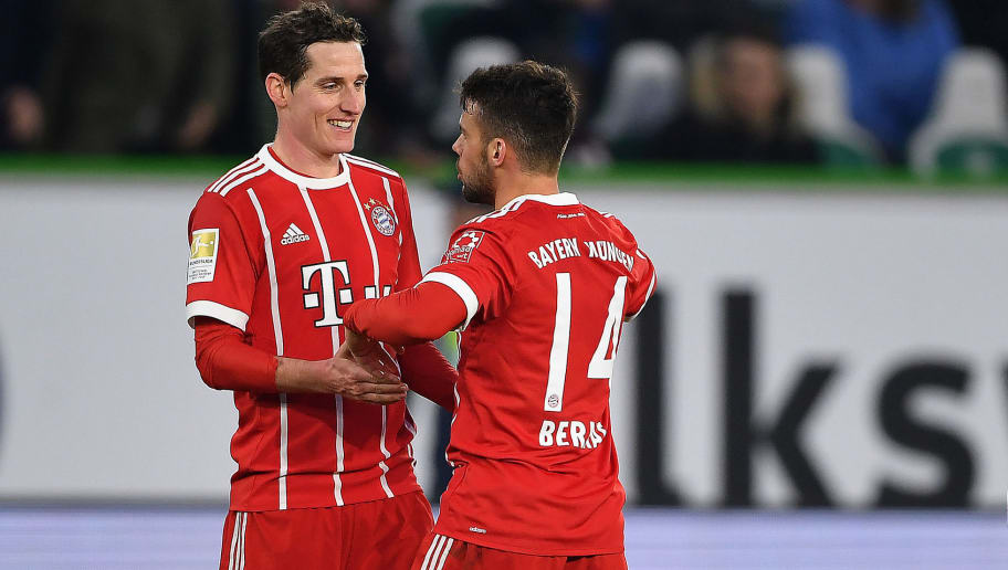 WOLFSBURG, GERMANY - FEBRUARY 17: (L-R:) Sebastian Rudy of Bayern Muenchen, Juan Bernat of Bayern Muenchen and Thomas Mueller of Bayern Muenchen celebrate after the Bundesliga match between VfL Wolfsburg and FC Bayern Muenchen at Volkswagen Arena on February 17, 2018 in Wolfsburg, Germany. (Photo by Stuart Franklin/Bongarts/Getty Images)