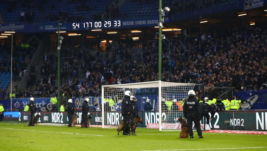 HAMBURG, GERMANY - FEBRUARY 17: Police forces enter the pitch with dogs in front of the Hamburg stand after the Bundesliga match between Hamburger SV and Bayer 04 Leverkusen at Volksparkstadion on February 17, 2018 in Hamburg, Germany. (Photo by Martin Rose/Bongarts/Getty Images)