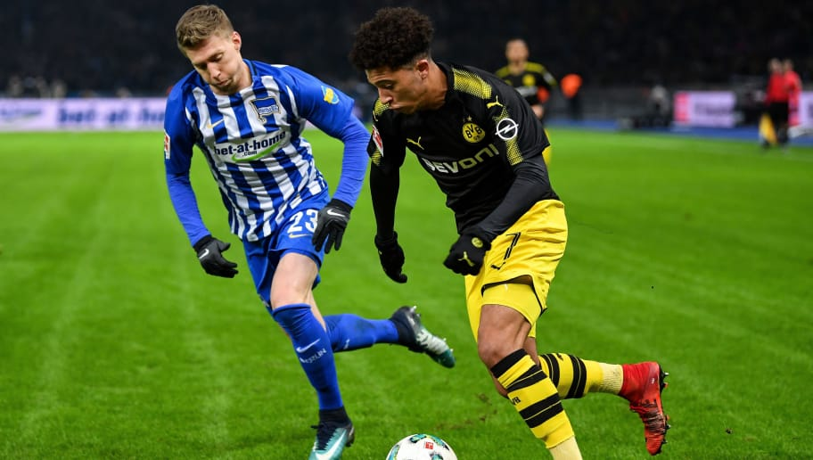BERLIN, GERMANY - JANUARY 19: Jadon Sancho #7 of Borussia Dortmund (R) and Mitchell Weiser #23 of Hertha Berlin battle for the ball during the Bundesliga match between Hertha BSC and Borussia Dortmund at Olympiastadion on January 19, 2018 in Berlin, Germany. (Photo by Stuart Franklin/Bongarts/Getty Images)