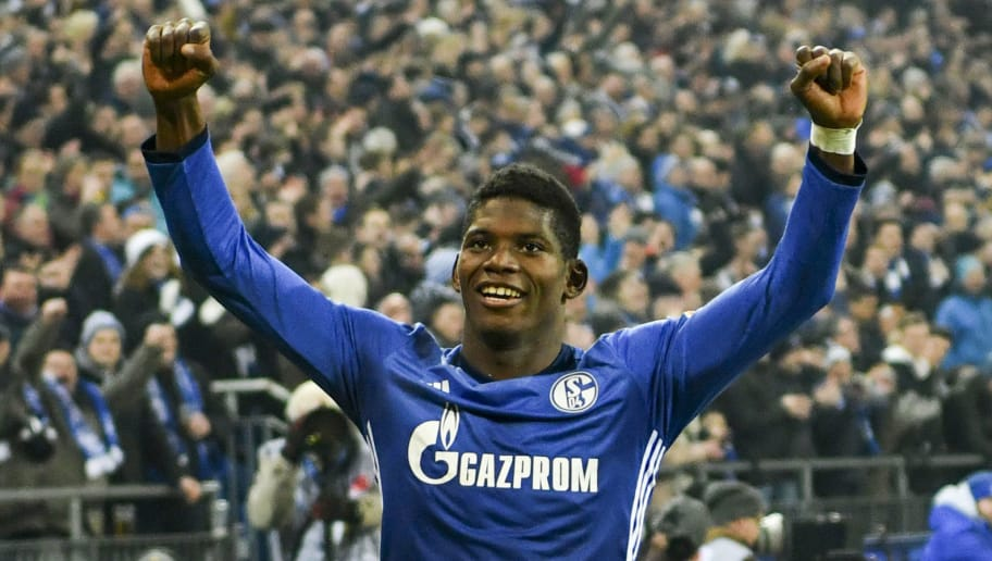Schalke's Swiss forward Breel Embolo celebrates after scoring during the German first division Bundesliga football match FC Schalke 04 vs Hoffenheim, in Gelsenkirchen, western Germany, on February 17, 2018. / AFP PHOTO / Patrik STOLLARZ / RESTRICTIONS: DURING MATCH TIME: DFL RULES TO LIMIT THE ONLINE USAGE TO 15 PICTURES PER MATCH AND FORBID IMAGE SEQUENCES TO SIMULATE VIDEO. == RESTRICTED TO EDITORIAL USE == FOR FURTHER QUERIES PLEASE CONTACT DFL DIRECTLY AT + 49 69 650050         (Photo credit should read PATRIK STOLLARZ/AFP/Getty Images)