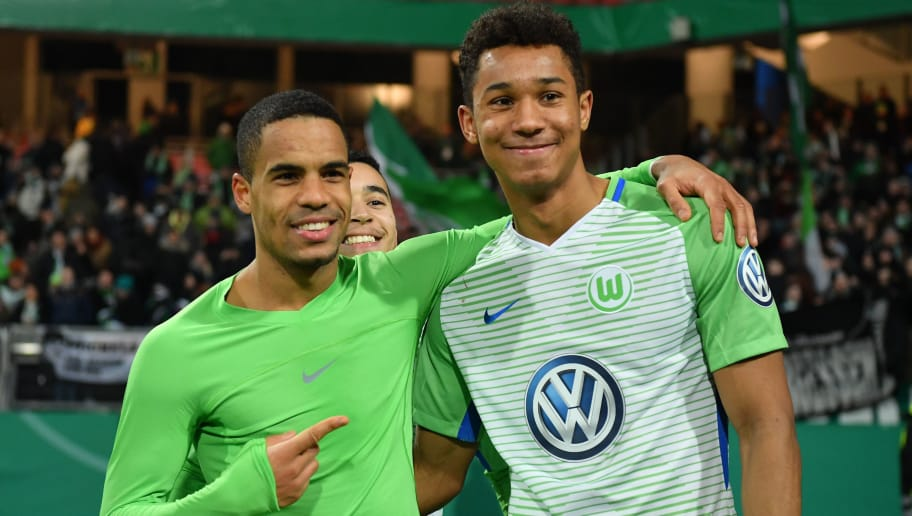 NUREMBERG, GERMANY - DECEMBER 19: Daniel Didavi and Felix Uduokhai of Wolfsburg celebrate after winning  the DFB Cup match between 1. FC Nuernberg and VfL Wolfsburg at Max-Morlock-Stadion on December 19, 2017 in Nuremberg, Germany. (Photo by Sebastian Widmann/Bongarts/Getty Images)