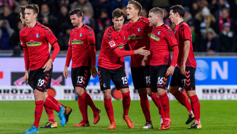 FREIBURG IM BREISGAU, GERMANY - DECEMBER 12: Nils Petersen of Freiburg celebrates the first goal for his team with his teammates during the Bundesliga match between Sport-Club Freiburg and Borussia Moenchengladbach at Schwarzwald-Stadion on December 12, 2017 in Freiburg im Breisgau, Germany. (Photo by Alexander Scheuber/Bongarts/Getty Images)