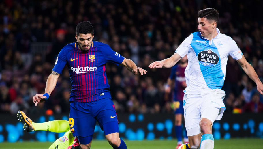 BARCELONA, SPAIN - DECEMBER 17:  Ruben Martinez of Deportivo La Coruna clears a ball conducted by Luis Suarez of FC Barcelona next to Fabian Schar of Deportivo La Coruna during the La Liga match between FC Barcelona and Deportivo La Coruna at Camp Nou on December 17, 2017 in Barcelona, Spain.  (Photo by Alex Caparros/Getty Images)
