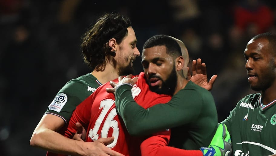 Saint-Etienne's French goalkeeper Stéphane Ruffier (c) is congratulated by Saint-Etienne's Bosnia and Herzegovina defender Neven Subotic (L), Saint-Etienne's French midfielder Yann M'vila (2NDR) and Saint-Etienne's French defender Kévin Théophile-Catherine (R) after the the French L1 Football match between Angers (SCO) and Saint-Etienne (ASSE), on February 17, 2018, at the Raymond Kopa Stadium, in Angers, northwestern France.  / AFP PHOTO / JEAN-FRANCOIS MONIER        (Photo credit should read JEAN-FRANCOIS MONIER/AFP/Getty Images)