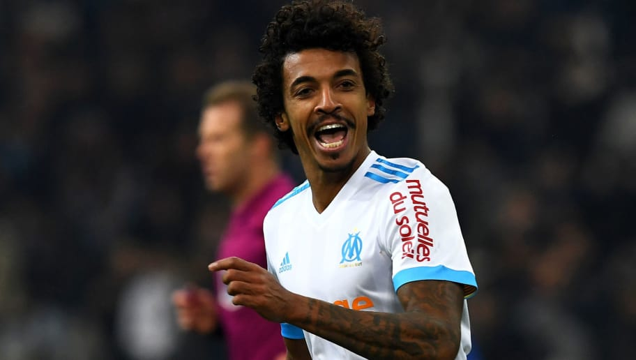 Olympique Marseille's Brazilian midfielder Luiz Gustavo (L) celebrates after scoring a goal during the French L1 football match between Olympique de Marseille (OM) and Troyes on December 20, 2017 at the Velodrome stadium in Marseille, southern France. / AFP PHOTO / ANNE-CHRISTINE POUJOULAT        (Photo credit should read ANNE-CHRISTINE POUJOULAT/AFP/Getty Images)