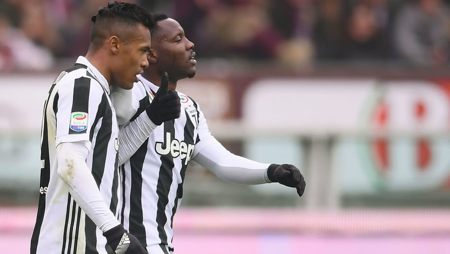 Juventus' Brazilian defender Alex Sandro (L) celebrates after scoring with Juventus' Ghanaian midfielder Kwadwo Asamoah during the Italian Serie A football match Torino vs Juventus on February 18, 2018 at the 'Stadio Grande Torino' in Turin. / AFP PHOTO / MARCO BERTORELLO        (Photo credit should read MARCO BERTORELLO/AFP/Getty Images)