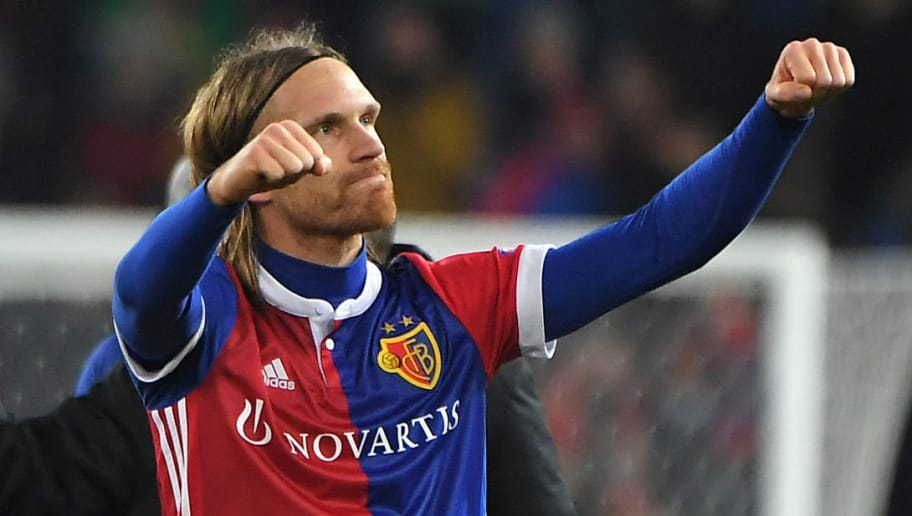Basel's Swiss defender Michael Lang celebrates at the end of the UEFA Champions League Group A football match between FC Basel and Manchester United at Saint Jakob-Park Stadium on November 22, 2017 in Basel.    / AFP PHOTO / PATRICK HERTZOG        (Photo credit should read PATRICK HERTZOG/AFP/Getty Images)