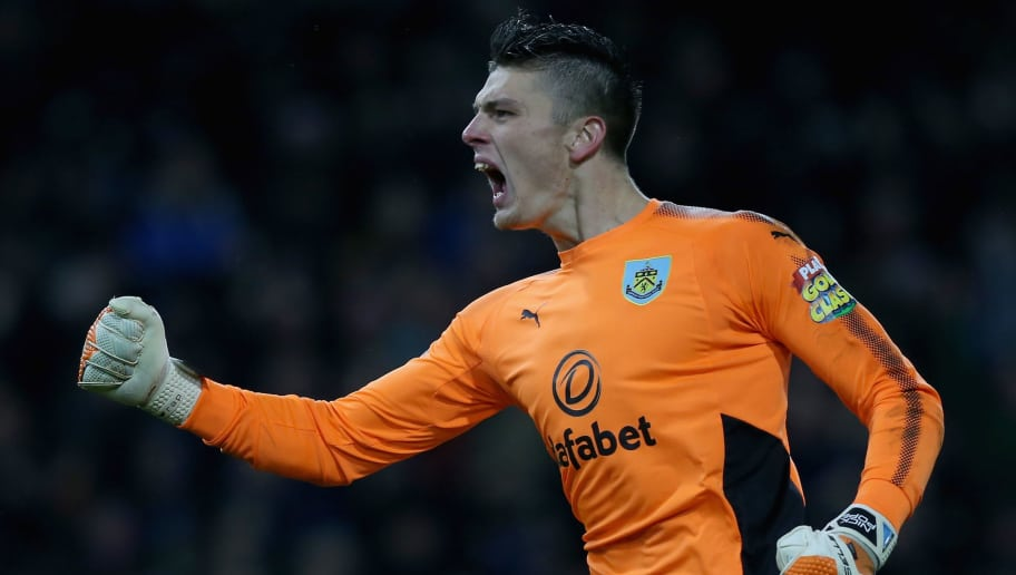 BURNLEY, ENGLAND - JANUARY 01: Nick Pope of Burnley celebrates his sides first goal during the Premier League match between Burnley and Liverpool at Turf Moor on January 1, 2018 in Burnley, England.  (Photo by Nigel Roddis/Getty Images)