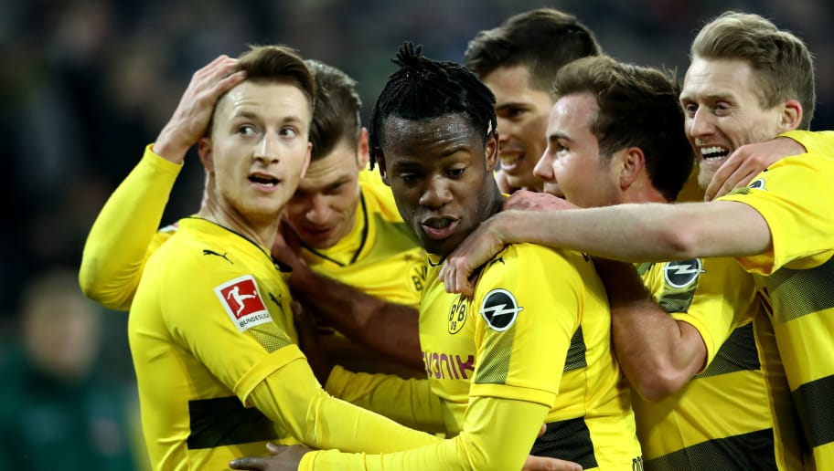 MOENCHENGLADBACH, GERMANY - FEBRUARY 18: Marco Reus of Dortmund (L) celebrates the first goal with his team mates during to the Bundesliga match between Borussia Moenchengladbach and Borussia Dortmund at Borussia-Park on February 18, 2018 in Moenchengladbach, Germany. (Photo by Christof Koepsel/Bongarts/Getty Images)