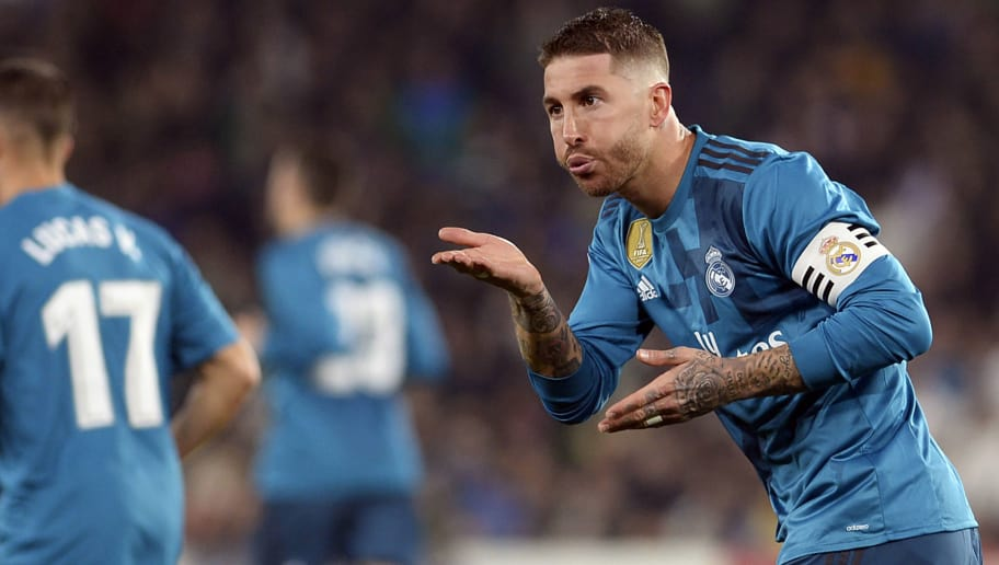 Real Madrid's Spanish defender Sergio Ramos celebrates scoring a goal during the Spanish league football match Real Betis vs Real Madrid at the Benito Villamarin stadium in Sevilla on February 18, 2018. / AFP PHOTO / Cristina Quicler        (Photo credit should read CRISTINA QUICLER/AFP/Getty Images)