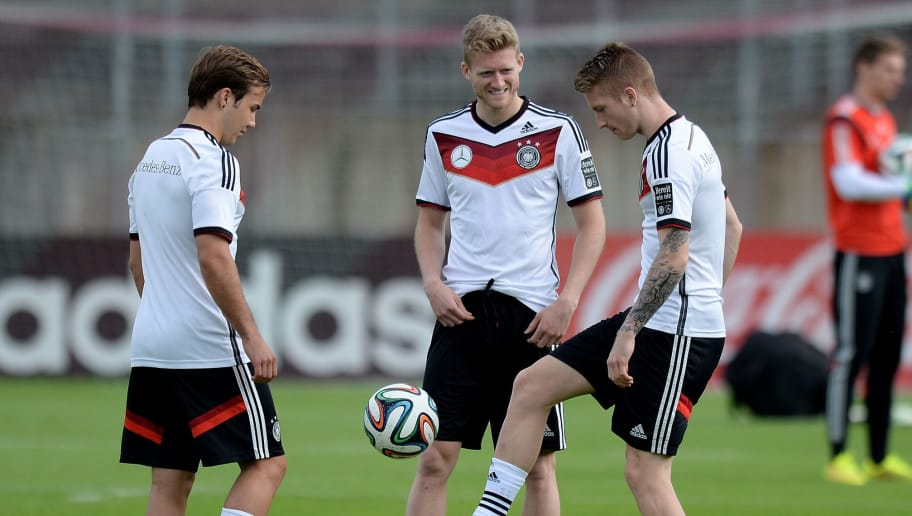 DUESSELDORF, GERMANY - MAY 31:  (L-R) Mario Goetze, Andre Schuerrle and Marco Reus of Germany warm up during a training session of the German national football team at Paul Janes Stadion on May 31, 2014 in Duesseldorf, Germany.  (Photo by Sascha Steinbach/Bongarts/Getty Images)