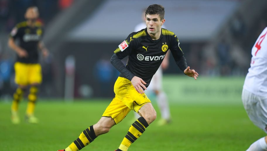 Dortmund's US midfielder Christian Pulisic vies for the ball during the German first division Bundesliga football match FC Cologne versus Borussia Dortmund in Cologne, western Germany, on February 2, 2018. / AFP PHOTO / Patrik STOLLARZ / RESTRICTIONS: DURING MATCH TIME: DFL RULES TO LIMIT THE ONLINE USAGE TO 15 PICTURES PER MATCH AND FORBID IMAGE SEQUENCES TO SIMULATE VIDEO. == RESTRICTED TO EDITORIAL USE == FOR FURTHER QUERIES PLEASE CONTACT DFL DIRECTLY AT + 49 69 650050         (Photo credit should read PATRIK STOLLARZ/AFP/Getty Images)