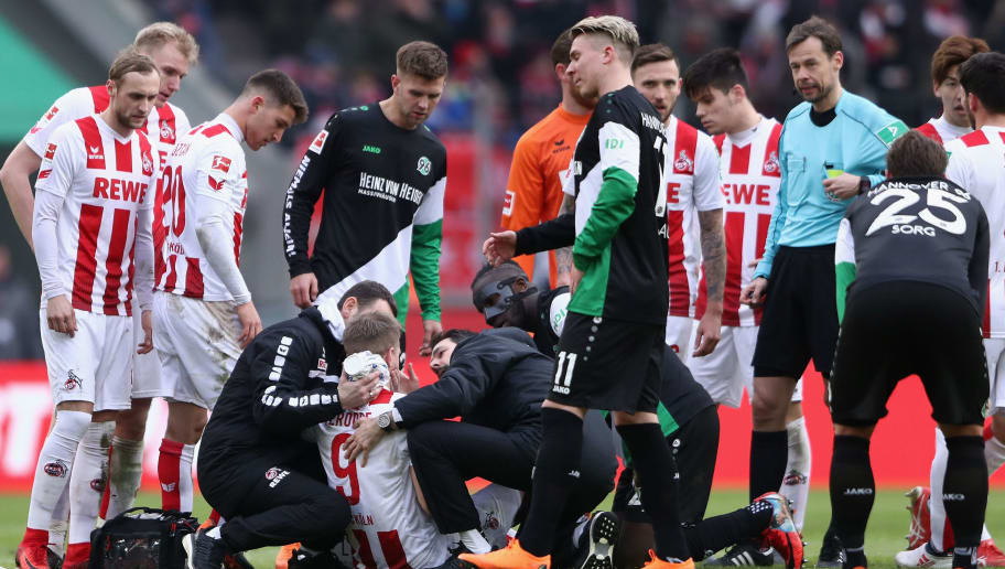 COLOGNE, GERMANY - FEBRUARY 17: Simon Terodde of Koeln receives treatment during the Bundesliga match between 1. FC Koeln and Hannover 96 at RheinEnergieStadion on February 17, 2018 in Cologne, Germany.  (Photo by Alex Grimm/Bongarts/Getty Images)