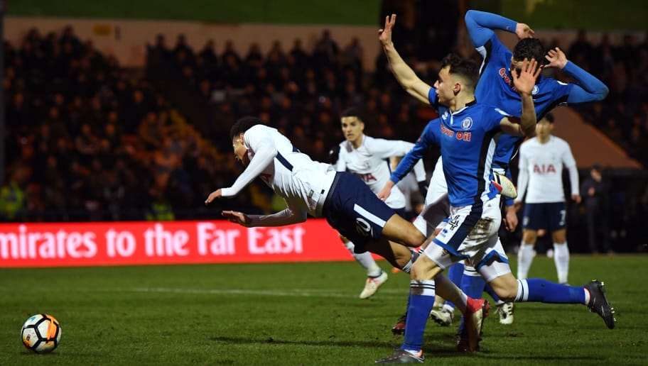 ROCHDALE, ENGLAND - FEBRUARY 18:  Dele Alli of Tottenham Hotspur is tripped for a penalty during The Emirates FA Cup Fifth Round match between Rochdale and Tottenham Hotspur on February 18, 2018 in Rochdale, United Kingdom.  (Photo by Gareth Copley/Getty Images)