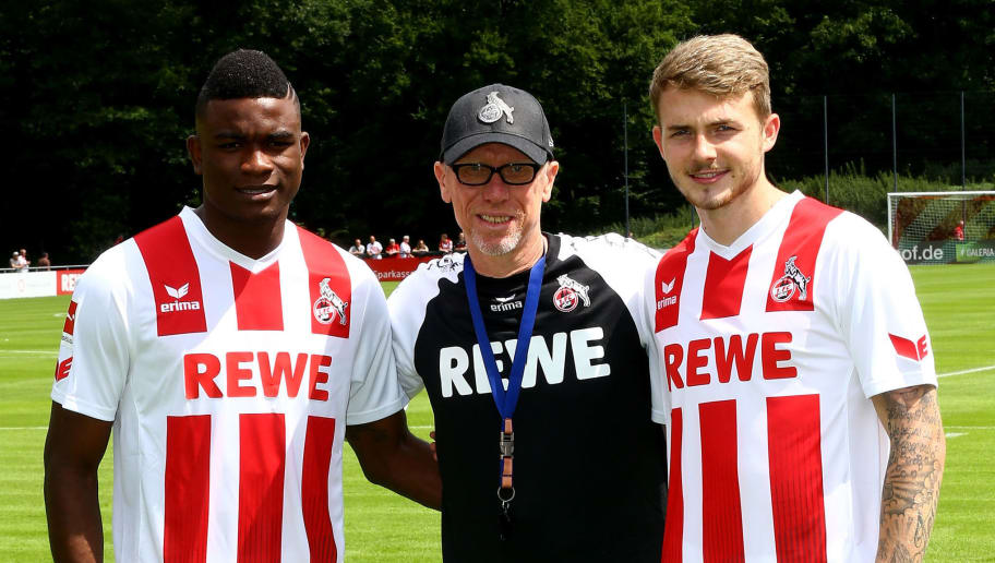 COLOGNE, GERMANY - JULY 03:  (L-R) New player Jhon Cordoba, head coach Peter Stoeger and Jannes Horn pose during the training session of 1. FC Koeln at RheinEnergieSportpark on July 3, 2017 in Cologne, Germany.  (Photo by Christof Koepsel/Bongarts/Getty Images)