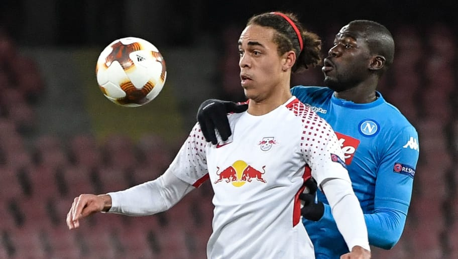 Leipzig's Danish forward Yussuf Poulsen (L) controls the ball with Napoli's French defender Kalidou Koulibaly during the UEFA Europa League football match between Napoli and Leipzig, on February 15, 2018 at San Paolo stadium in Naples.  / AFP PHOTO / Andreas SOLARO        (Photo credit should read ANDREAS SOLARO/AFP/Getty Images)