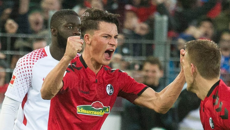 Freiburg's German defender Robin Koch (C) celebrates with Freiburg's German forward Nils Petersen after scoring the 2-1 during the German first division Bundesliga football match SC Freiburg vs RB Leipzig in Freiburg, southwestern Germany, on January 20, 2018. / AFP PHOTO / THOMAS KIENZLE / RESTRICTIONS: DURING MATCH TIME: DFL RULES TO LIMIT THE ONLINE USAGE TO 15 PICTURES PER MATCH AND FORBID IMAGE SEQUENCES TO SIMULATE VIDEO. == RESTRICTED TO EDITORIAL USE == FOR FURTHER QUERIES PLEASE CONTACT DFL DIRECTLY AT + 49 69 650050         (Photo credit should read THOMAS KIENZLE/AFP/Getty Images)